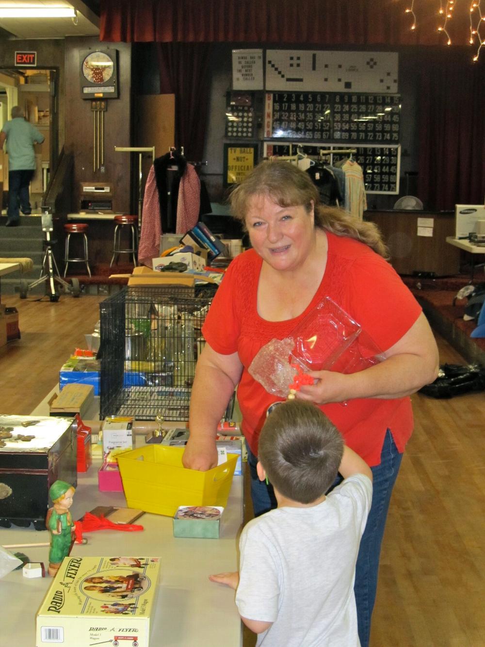 Joy Malone setting up the Elkette rummage sale