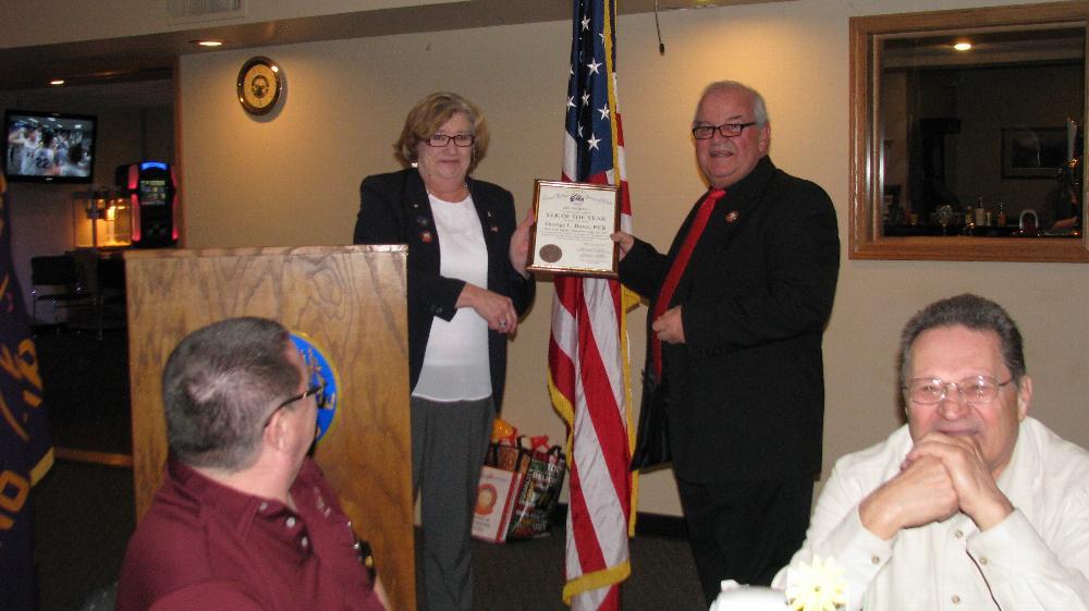 ER Marilyn Gillies presents Elk of the Year Award to George Bures
