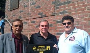 PER John Gosch and Pedro Rosa present an Autism volunteer t-shirt to Schenectady Mayor Gary McCarthy.