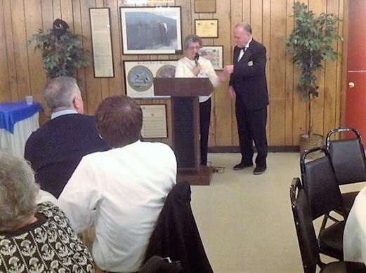 Joan Freyman, LOTES President giving donation to Robert Boggs, ER